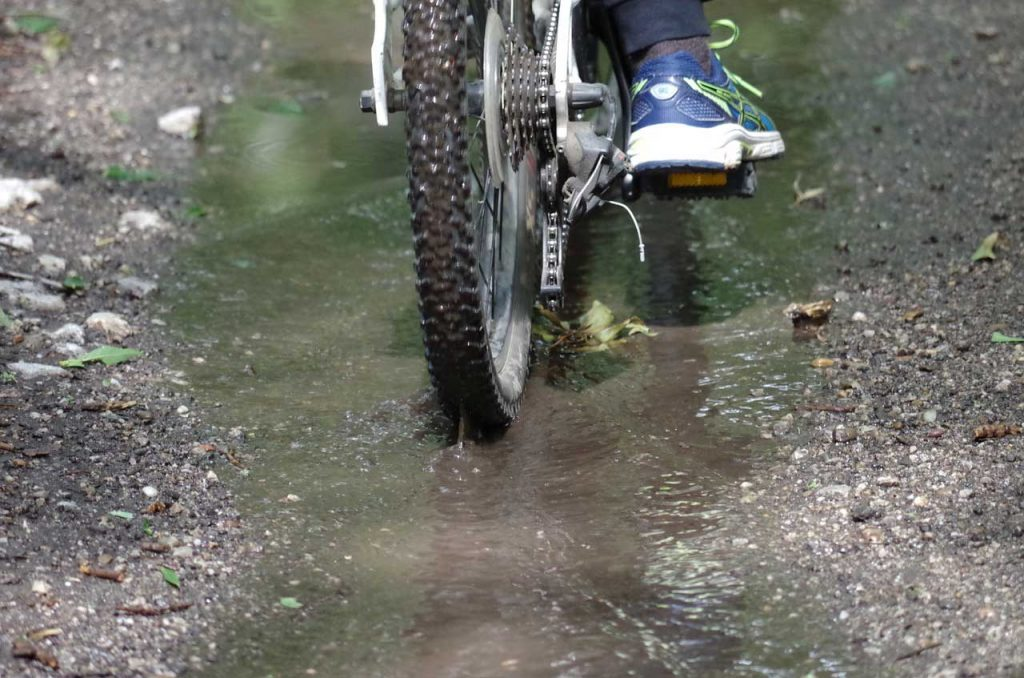 electric-bicycle-driving-through-water